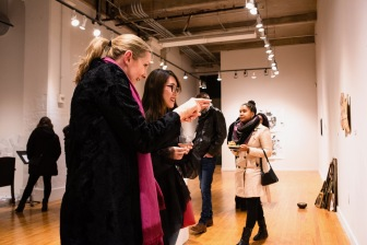"Sixue Yang (right) talks with Patricia Olynyk, Director, Graduate School of Art, Sam Fox School of Design & Visual Arts, about her piece ""Fusing"" at the Parabola: Assembly exhibition, Des Lee Gallery, Washington University, St. Louis, MO"