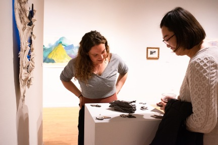 "Sarah Knight (left) talks with Medical student Bo Yang about her piece ""Gorges of Your Exalted Body,"" Parabola: Assembly exhibition, Des Lee Gallery, Washington University, St. Louis, MO"