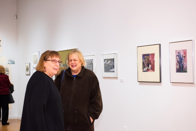 Robert C. Smith's daughter, Kathy Vice, speaks with a gallery visitor at her father's Retrospective Exhibit Opening, Des Lee Gallery, St. Louis, MO