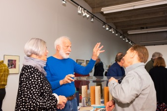 Rick Smith (right), son of Robert C. Smith, talks with SFS former faculty member Sarah Birdsall and Sam Mitchell at the Robert C. Smith Retrospective Exhibit Opening, Des Lee Gallery, St. Louis, MO