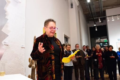 Robert C. Smith's daughter, Val Smith, gives remarkes at her father's Retrospective Exhibit Opening, Des Lee Gallery, St. Louis, MO