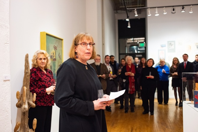 Robert C. Smith's daughter, Kathy Vice, gives remarks at her father's Retrospective Exhibit Opening, Des Lee Gallery, St. Louis, MO