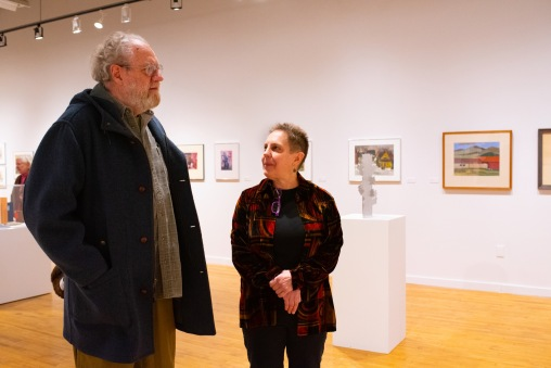 Val Smith, (Robert C. Smith's daughter and WU alum) talks with Dick Bischoff at her father's Retrospective Exhibit Opening, Des Lee Gallery, St. Louis, MO