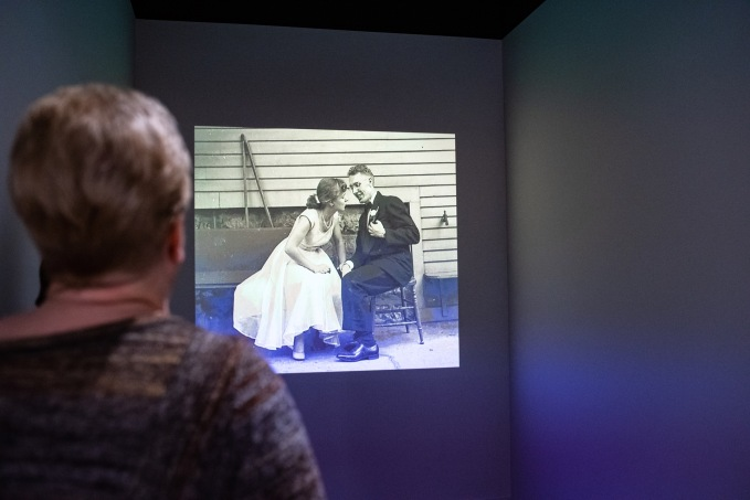 Attendees viewing a Slide Show at the Robert C. Smith Retrospective Exhibit Opening, Des Lee Gallery, St. Louis, MO