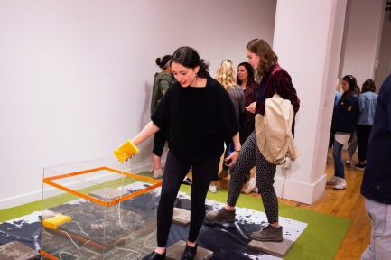 "From left, Juilet Roll and Georgina Halper interact with the installation ""30minutes"" by Megan Jiyoung Lee at the BFA 2 Show on display at the Des Lee Gallery, Washington University, St. Louis, MO"