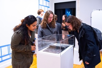 """Shameen Akhtar (l), Maddy Peters (c), Emily Haller view work on display at the """"Decoys and Depictions: Images of the Digital"""" Exhibition at the Des Lee Gallery, Washington University, St. Louis, MO"""