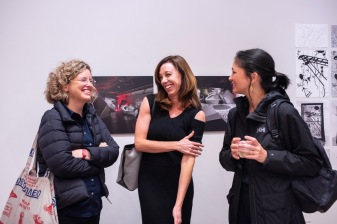 """Heather Woofter (l), Director of College of Architecture, Architect Karel Klein (c), and Prof. Valerie Greer (r) talk at the Opening Reception of the """"Decoys and Depictions: Images of the Digital"""" Exhibition at the Des Lee Gallery, Washington University, St. Louis, MO"""