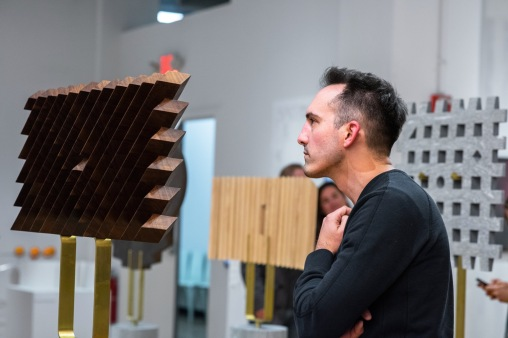"""Curtis Roth, from Ohio State University, views work at the Opening Reception of the """"Decoys and Depictions: Images of the Digital"""" Exhibition at the Des Lee Gallery, Washington University, St. Louis, MO"""