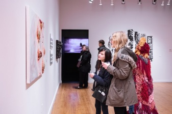 Cristalyn Borek (c) and Brie Henderson (r) attend the Parabola: Extraterrestrial Exhibit Opening, Des Lee Gallery, Washington University, St. Louis, MO