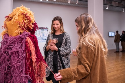 "Liz Moore (r) talks with Ellen Ward about her piece ""Untitled (color and breath/underneath they're living)""on display at the Parabola: Extraterrestrial Exhibit, Des Lee Gallery, Washington University, St. Louis, MO"